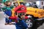 The Mario Bros. cruising by the LA Auto Show showroom floors.